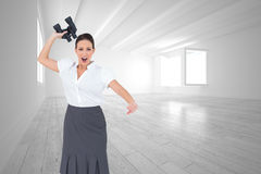 Angry businesswoman throwing binoculars away Stock Photo