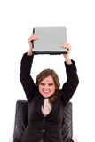 Angry businesswoman throwing her laptop. On white Royalty Free Stock Photography