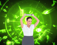 Angry businesswoman throwing her tablet pc Stock Image