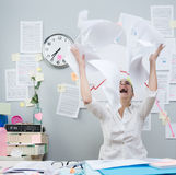 Angry businesswoman throwing paperwork in air Stock Photo