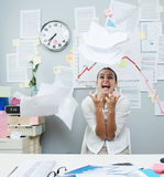 Angry businesswoman throwing paperwork in air stock photos