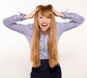 Angry businesswoman  on white Stock Images