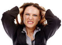 Angry businesswoman on white background Stock Photo