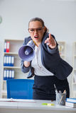 The angry businesswoman yelling with loudspeaker in office Stock Photos