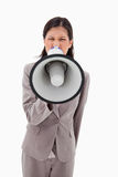 Angry businesswoman yelling through megaphone Royalty Free Stock Photography