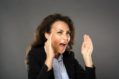 Angry businesswoman yelling Stock Image