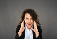 Angry businesswoman yelling Royalty Free Stock Photography