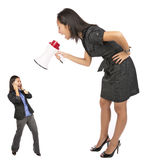 Angry businesswoman  yelling. Angry businesswoman yellong to  a coleg  with a megafon Stock Image