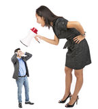 Angry businesswoman  yelling. Angry businesswoman yellong to  a coleg  with a megafon Royalty Free Stock Photos