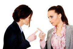 Angry businesswomans pointing on each other. Royalty Free Stock Photos