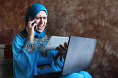 Angry busy arab muslim businesswoman Stock Images