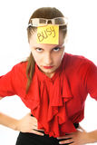 Angry busy businesswoman. Portrait of an angry businesswoman with a note busy on her forehead Stock Photo