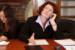Angry caller. Young office employee or boss has frustrating conversation on cell phone stock photo