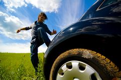 Angry At Car 2. Man kicking car in anger Royalty Free Stock Image
