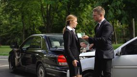 Angry car accident female victim throwing money compensation in guilty driver. Stock footage stock video footage