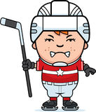 Angry Cartoon Hockey Player. A cartoon illustration of a child hockey player looking angry Royalty Free Stock Images