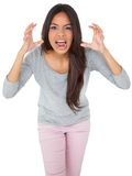 Angry casual young brunette shouting Stock Images