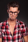 Angry casual young man wearing glasses. On black background Royalty Free Stock Image