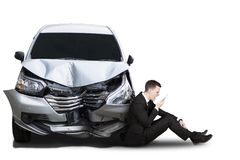 Angry businessman with broken car Royalty Free Stock Image