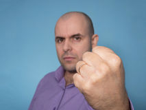 Angry Caucasian man with clenched fist. Angry Caucasian bald man with clenched fist Stock Photos