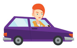 Angry caucasian woman in car stuck in traffic jam. Royalty Free Stock Photography
