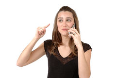 Angry on Cell phone. Woman is upset on her cell phone with who ever is on the other line Royalty Free Stock Photography