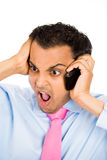 Angry on cell phone Stock Photos