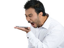 Angry on cellphone Stock Images