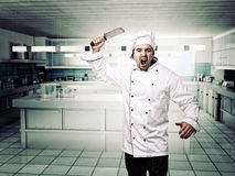 Angry chef. Portrait of angry chef in modern kitcken stock photo
