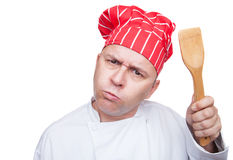 Angry chef. With red hat isolated on white background Stock Photography