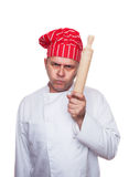 Angry chef. With red hat and rolling pin isolated on white background Stock Image