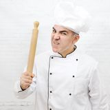 Angry chef with rolling pin Royalty Free Stock Photography