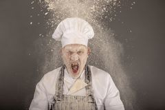 Angry chef shouting in a flour cloud. Taken with copy space stock photos