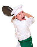 Angry chief in hood threaten by pan Stock Image
