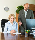 Angry chief and secretary in office Stock Photos