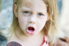 Angry Child. Angry toddler throwing a tantrum. Very unhappy Royalty Free Stock Image