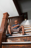Angry child. Sitting on a wooden stair case Royalty Free Stock Image
