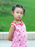 Angry child. The little girl may be angry royalty free stock image