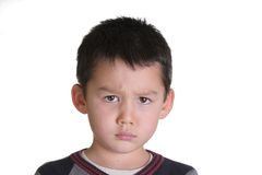 An angry child is looking at the camera Stock Photos