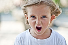 Angry child. Angry boy with blue eyes Stock Photo