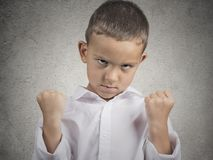 Angry child, boy with fist up in air, pissed off. Closeup portrait angry child boy with fist up in air, pissed off looking grumpy isolated grey wall background Stock Photography