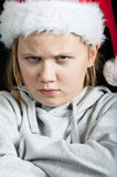 Angry child at christmas time Royalty Free Stock Image