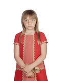 Angry child with a elegant red dress. Isolated on white background stock photo