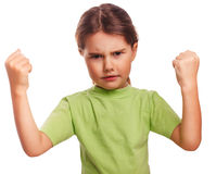 Angry child evil girl shows fists experiencing. Anger and isolated on white background stock photography