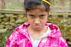 Angry child girl expression closeup portrait Royalty Free Stock Photo