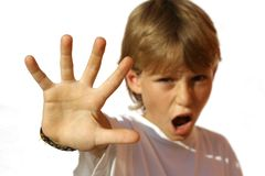 Angry child kid or boy. Holiding hand up royalty free stock photography
