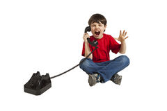 Angry child on the phone. Isolated on white background royalty free stock photos