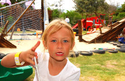 Angry child on playground Stock Photography