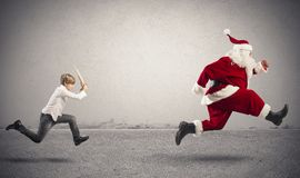 Angry child with Santa Claus Royalty Free Stock Image