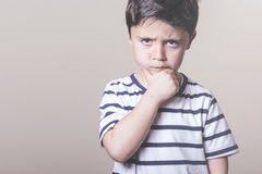 Angry child. With striped shirt Royalty Free Stock Photos